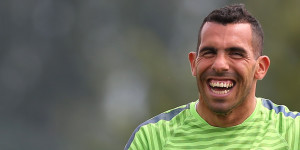 """Juventus' Argentinian forward Alberto Carlos Tevez takes part in a training session on the eve of the UEFA Champions League semi-final second-leg football match Real Madrid Vs Juventus on May 12, 2015 at the """"Juventus Training Center"""" in Vinovo, near Turin.  AFP PHOTO / MARCO BERTORELLO"""